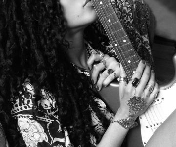 Mayaeni Rocks the World With Her Powerful Voice and Sick Guitar Skills